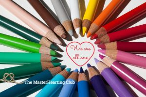 Image of coloured crayons with the message we are all one inside a heart
