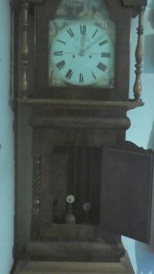 one of the family grandfather clocks, the actual inspiration of this post, showing the inside with the pendulum and weights