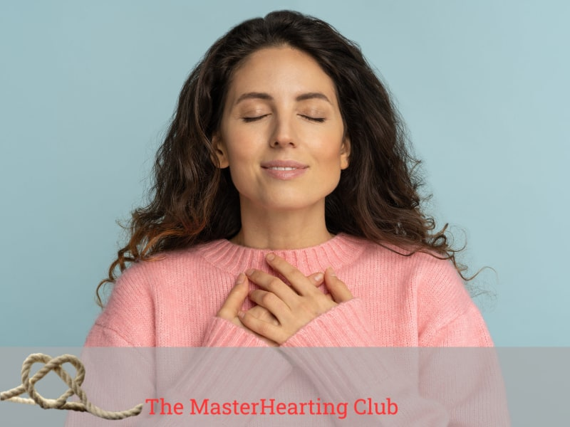image of woman with eyes closed, smiling and holding her hands on her heart